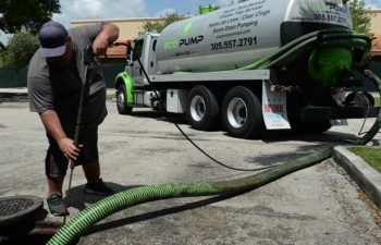 Eco Pump Services technician performing grease trap cleaning