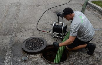Eco Pump Services technician performing hydro jetting